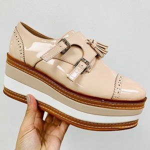 Nude patent striped loafer